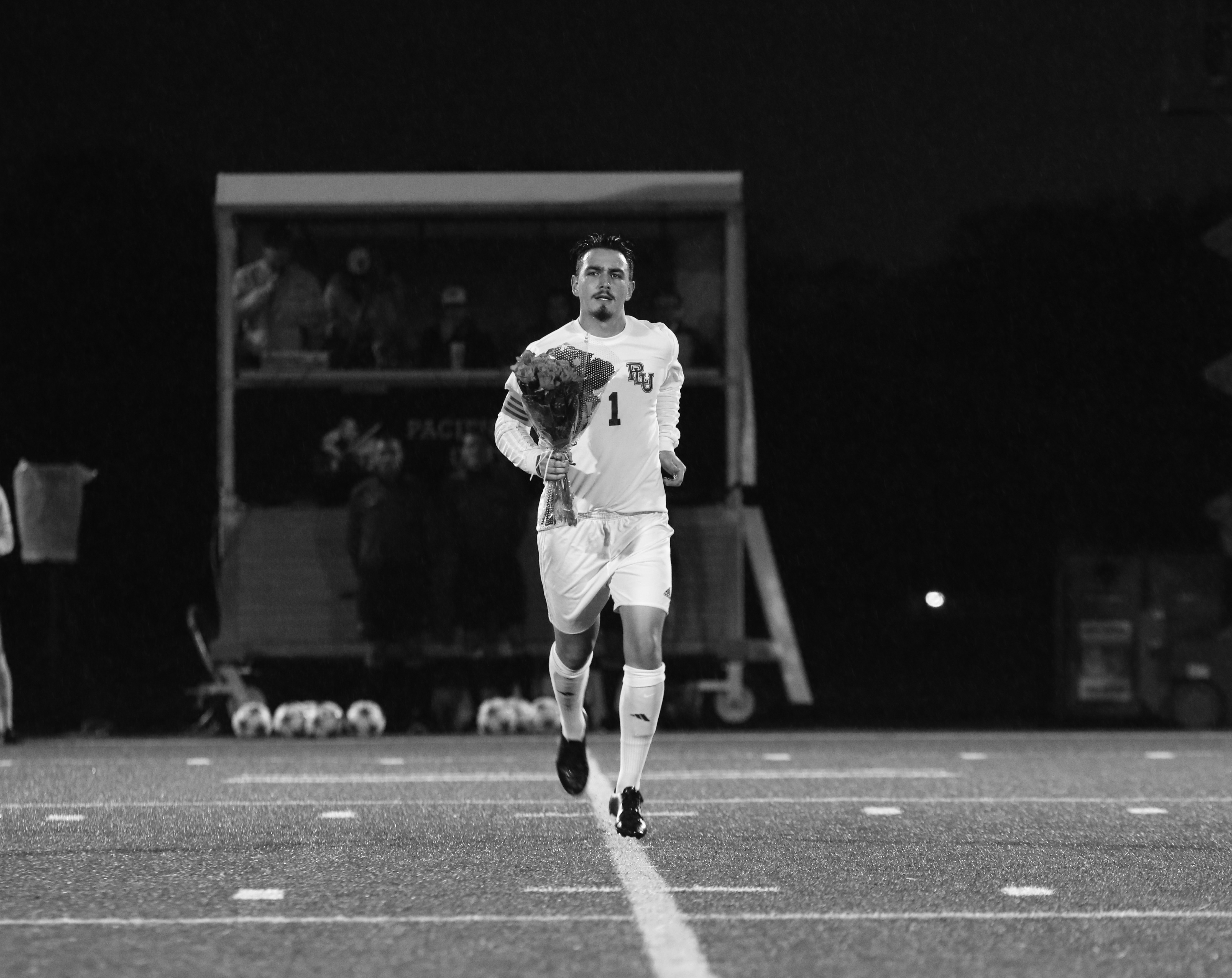 PHOTO BY BAILEY PLUMB: Senior goalie Mike Arguello being honored for Senior Night. Arguello gave up 10 goals in 14 Northwest Conference games with five shutouts.